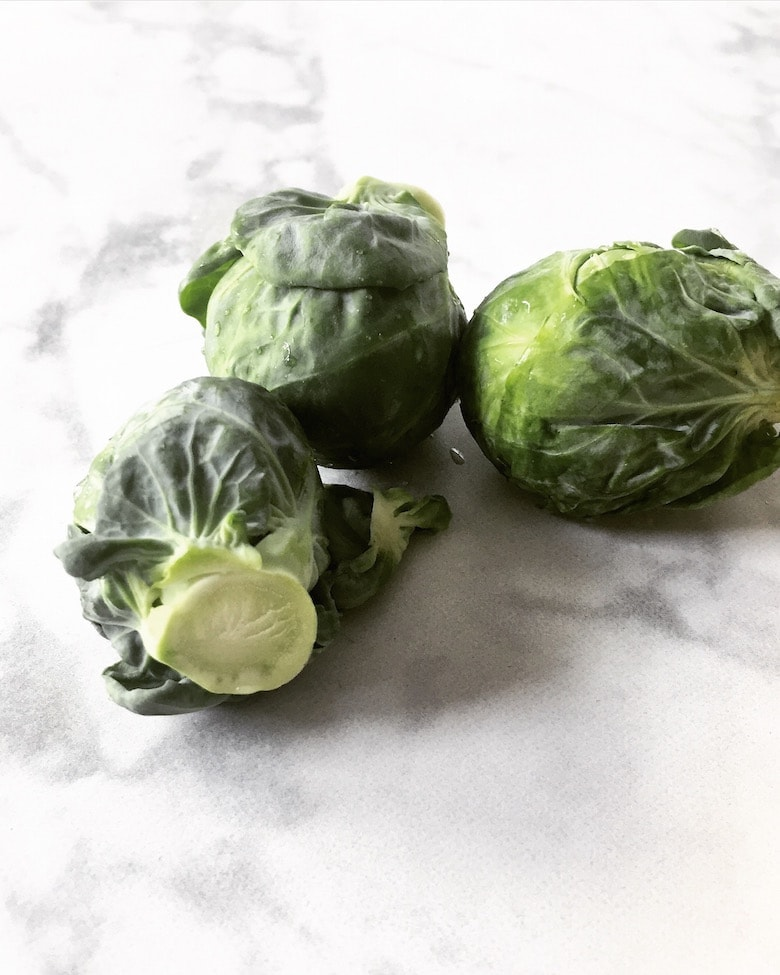 Spiced Brussel Sprouts - This quick and easy recipe is perfect for both brussel lovers and skeptics! It's the perfect side dish to any meal. | realandvibrant.com