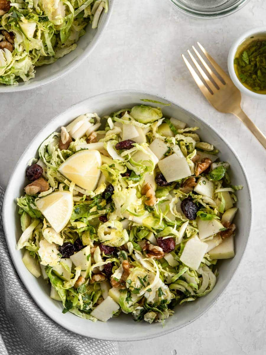 Bowl of shaved Brussels sprouts salad.