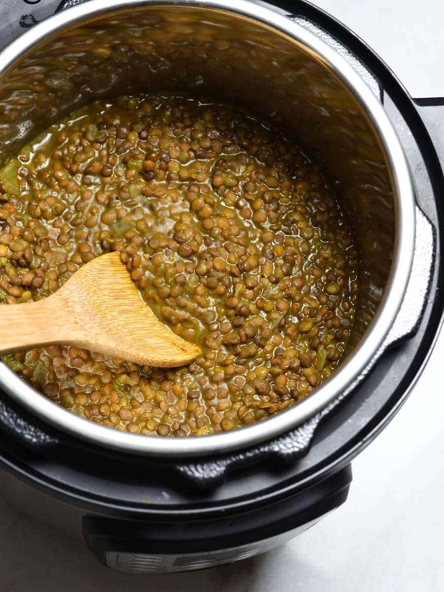 Instant Pot full of cooked lentil soup.
