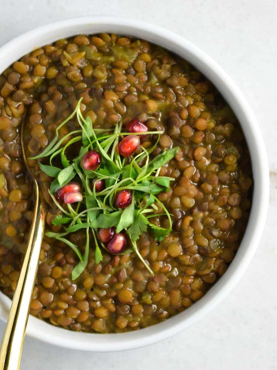 A bowl of lentil soup with a spoon
