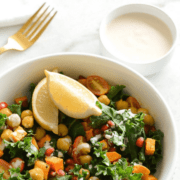 A roasted sweet potato and kale bowl.
