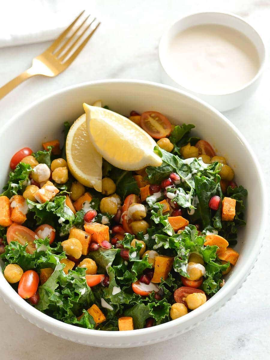 A sweet potato kale bowl with a side of tahini sauce.