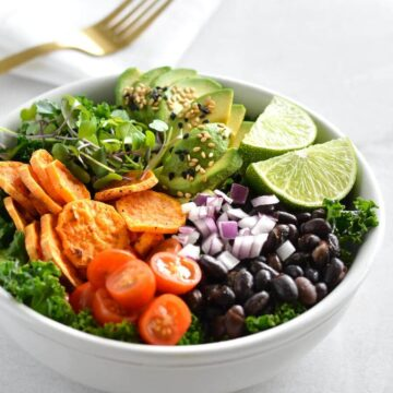 A sweet potato black bean bowl with a fork in the background