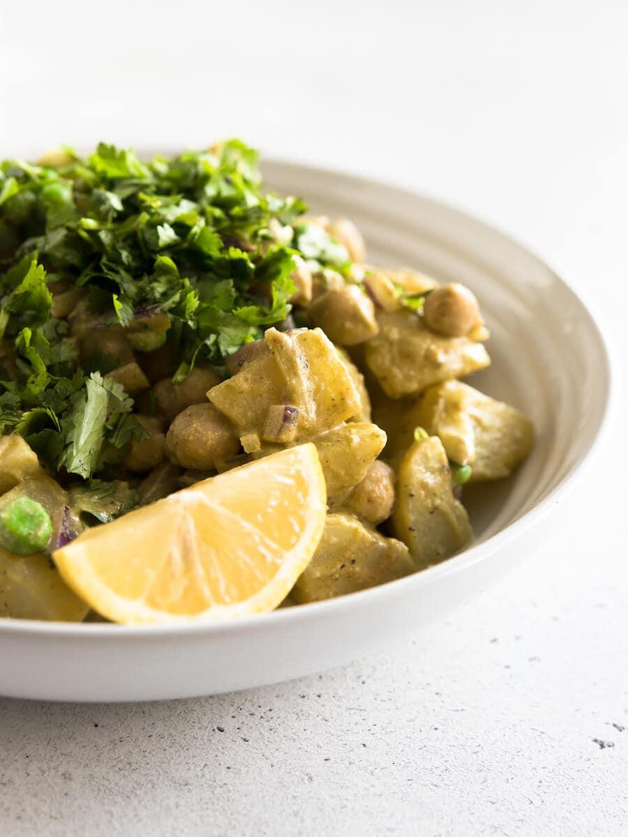 A bowl of Masala Potato Salad.