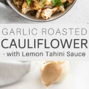 A bowl of garlic roasted cauliflower, drizzled with lemon tahini dressing.
