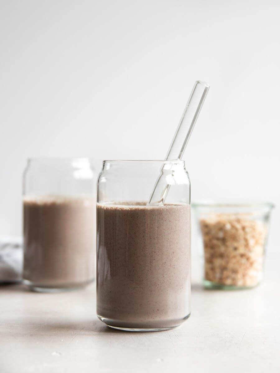 Two power breakfast smoothies and a container of rolled oats.
