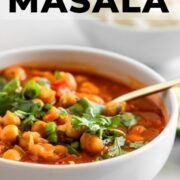 A delicious bowl of Indian chana masala., topped with fresh cilantro.