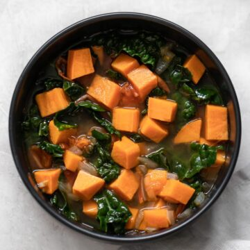 Bowl of sweet potato and kale soup.