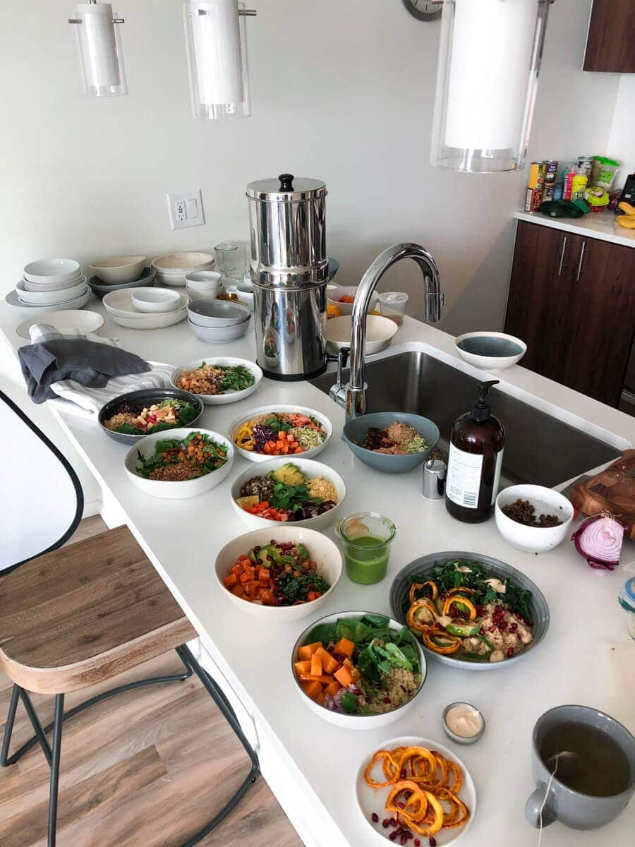 Kitchen counter filled with prepared bowls from photos shoots.