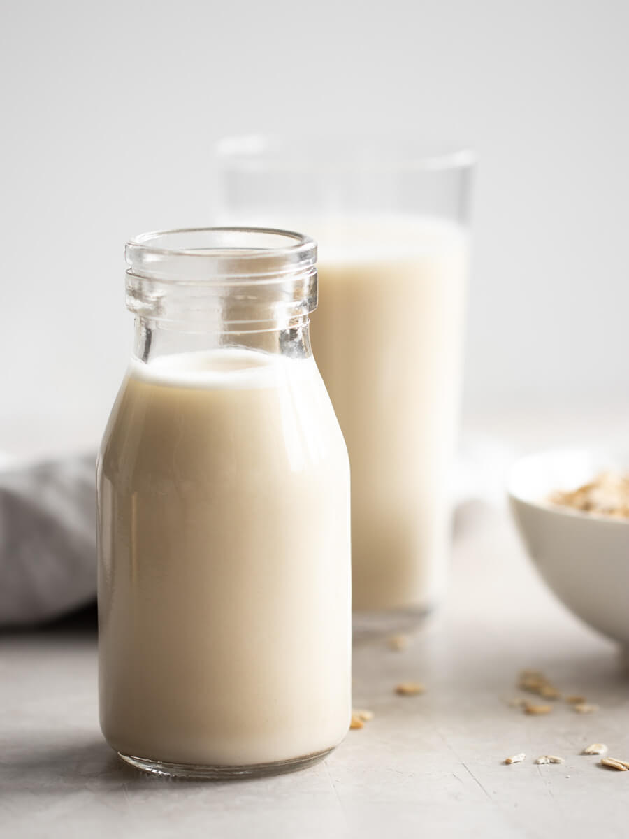 A glass bottle of oat milk.