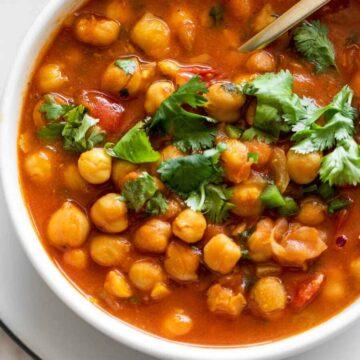 Bowl of chana masala with fresh cilantro
