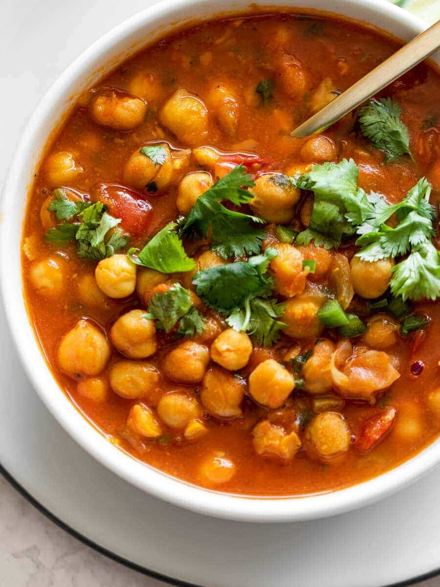 Bowl of chana masala with fresh cilantro