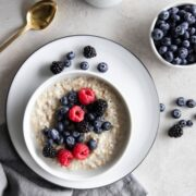 A bowl of overnight steel cut oats with fresh berries on top