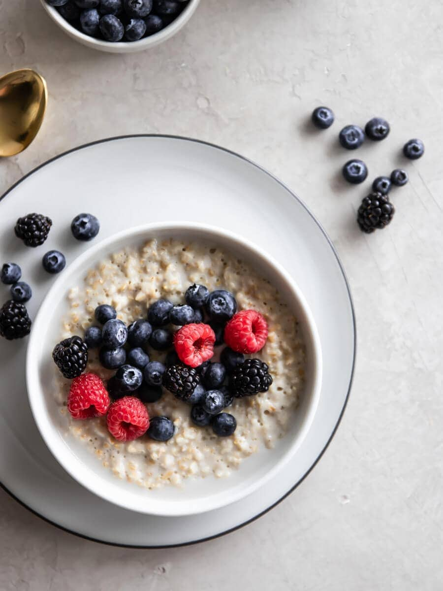 A bowl of overnight oats, topped with fresh berries.