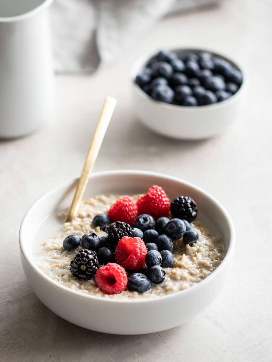 A bowl of vegan overnight oats, topped with fresh berries.