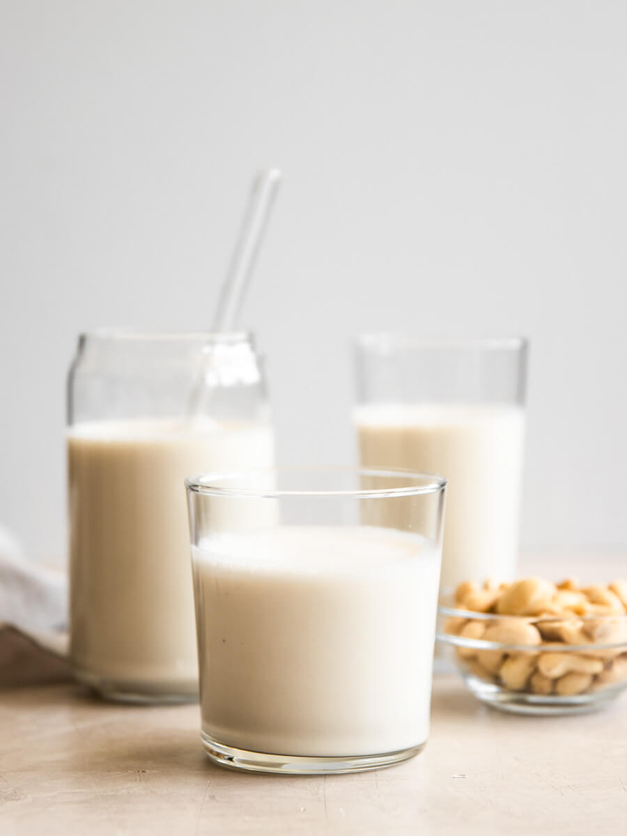 Three glasses of homemade cashew milk.