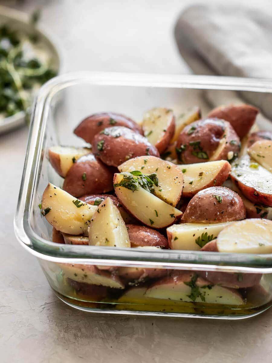 A glass bowl full of Italian potato salad.