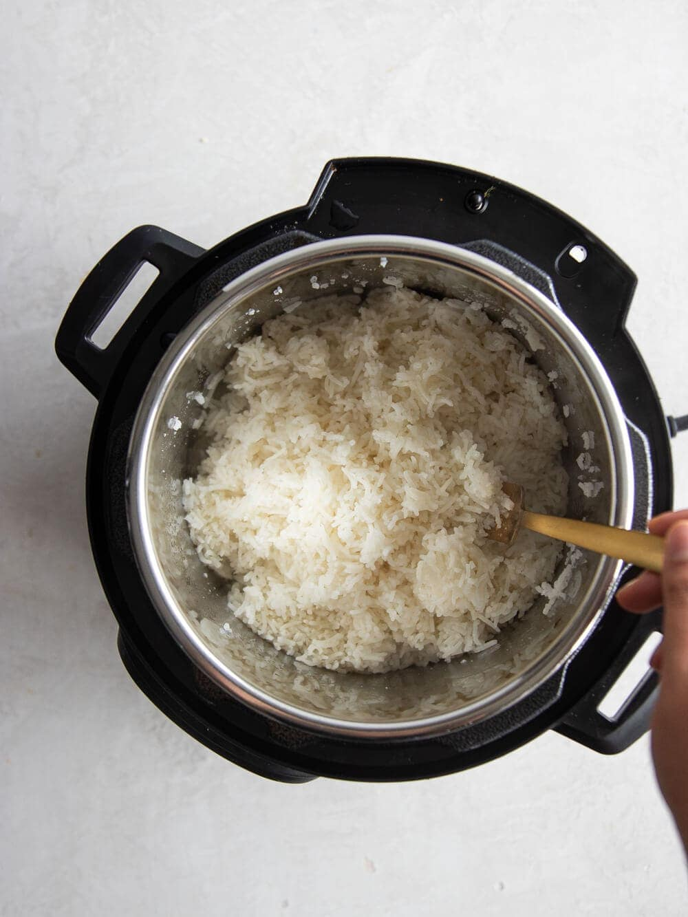 Fluffing the rice with a fork