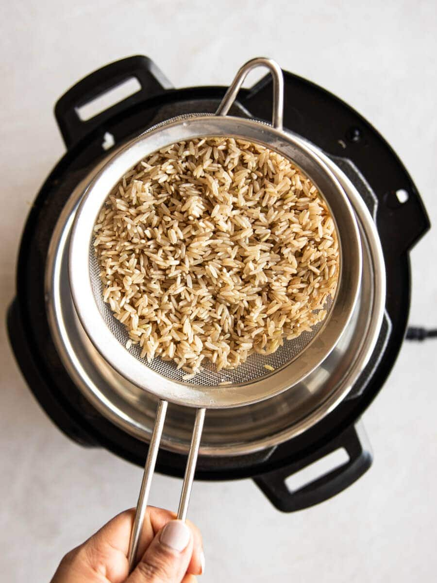 Brown rice in strainer