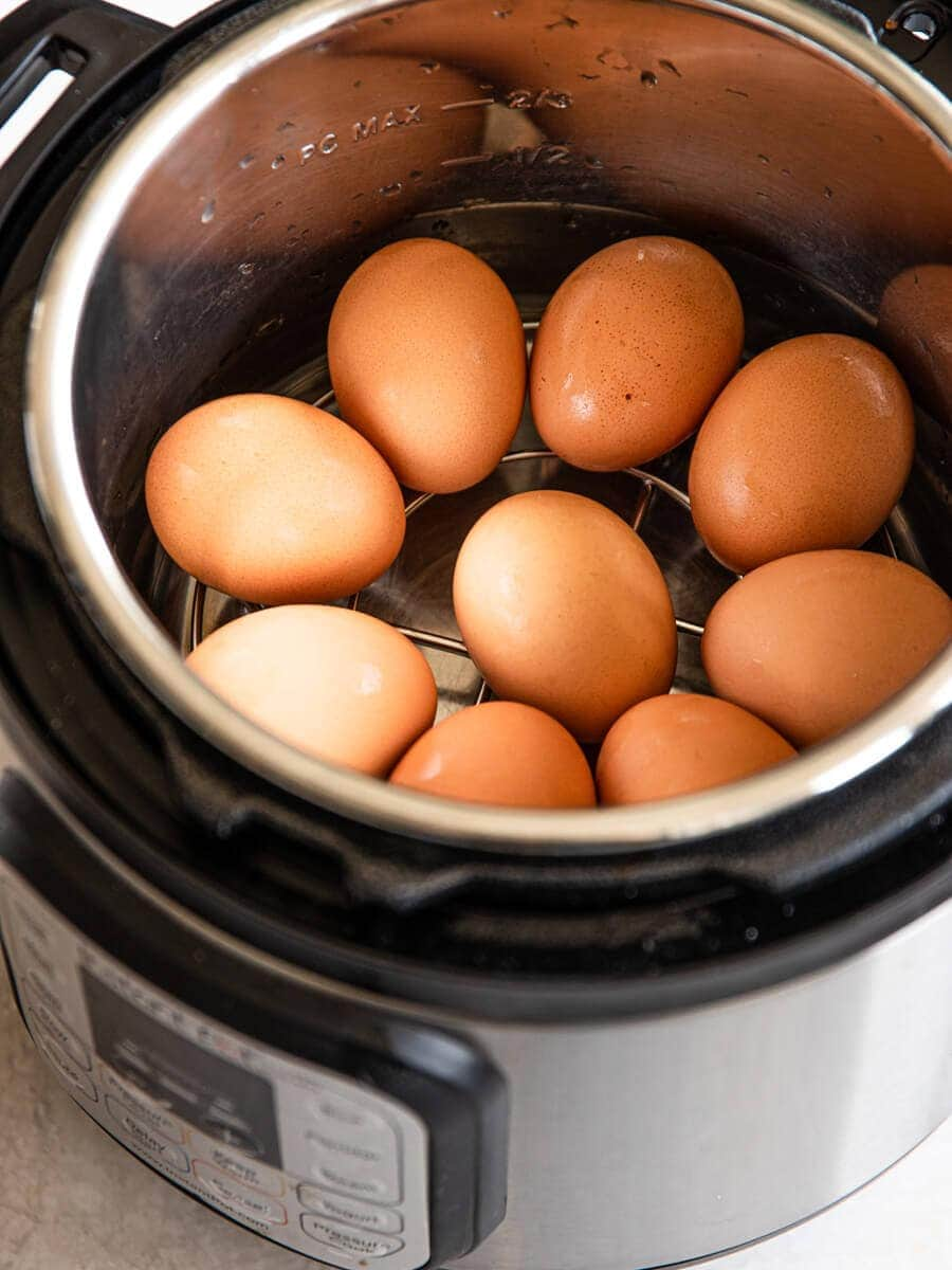 An Instant Pot filled with 9 eggs.