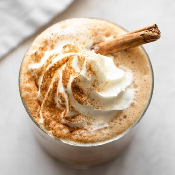 Iced pumpkin spice latte with whipped cream.