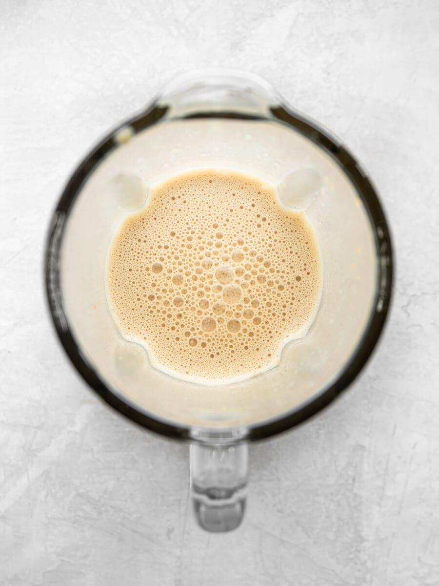 Blender filled with blended latte.