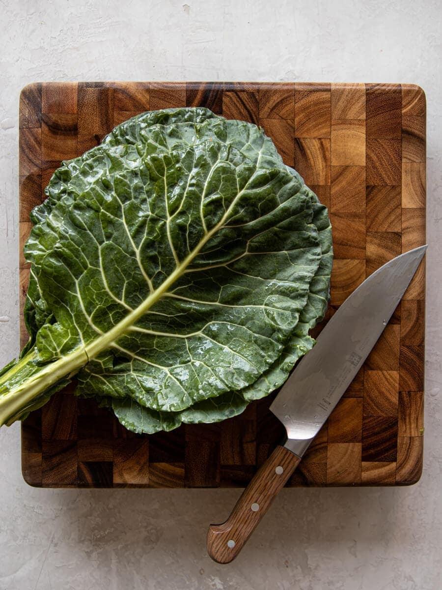 Fresh collard greens on a cutting board