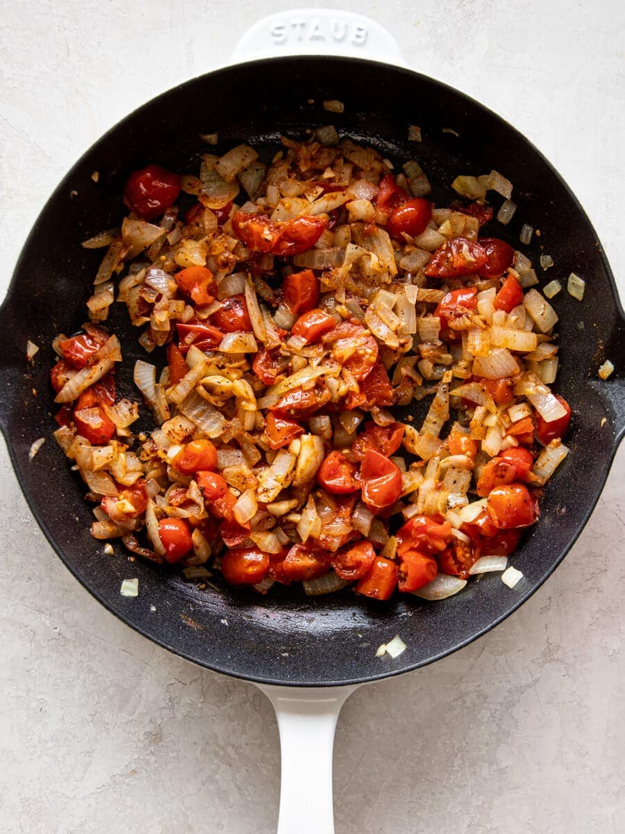 Cooked onions and tomatoes.