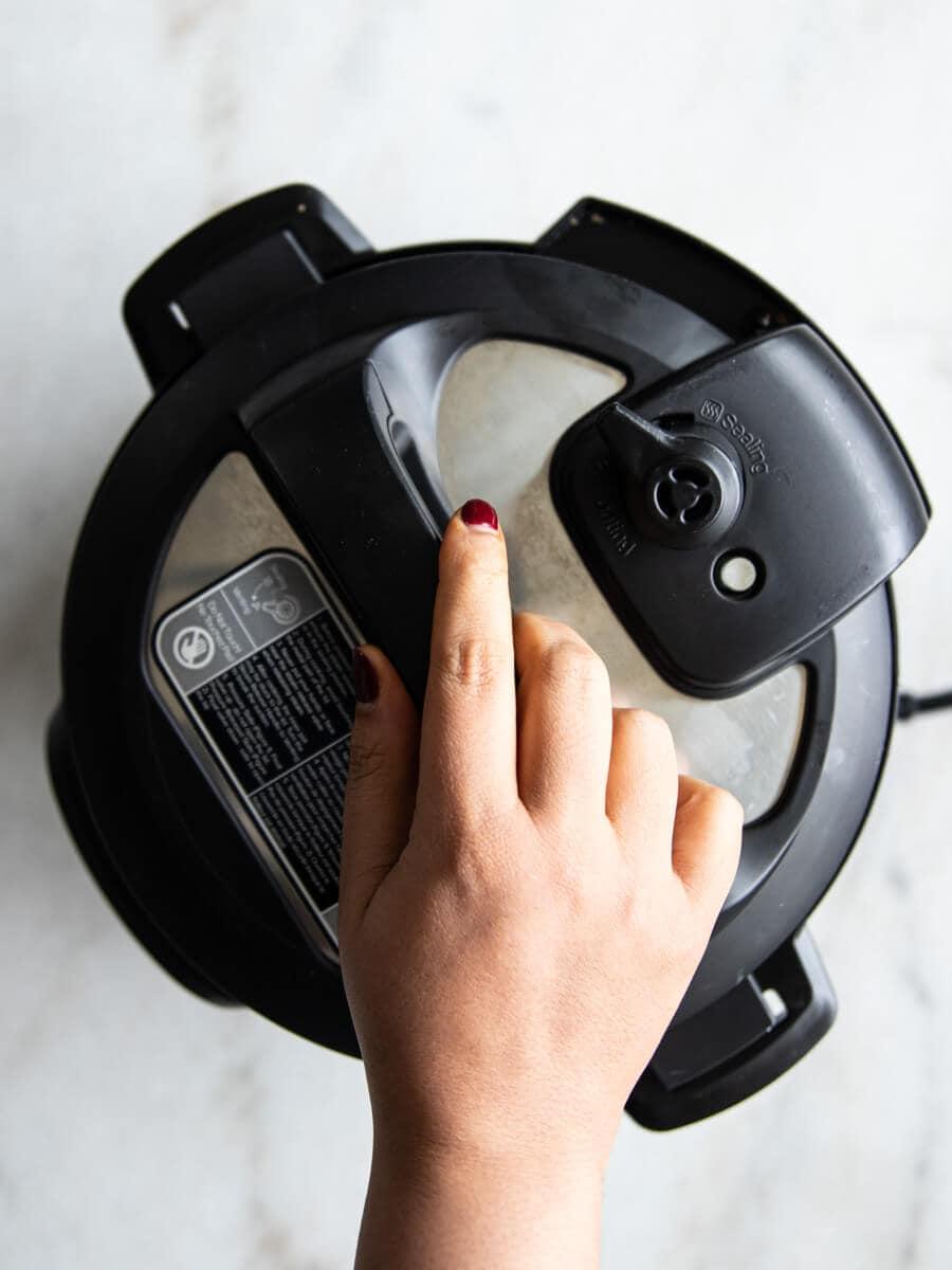 Hand closing Instant Pot