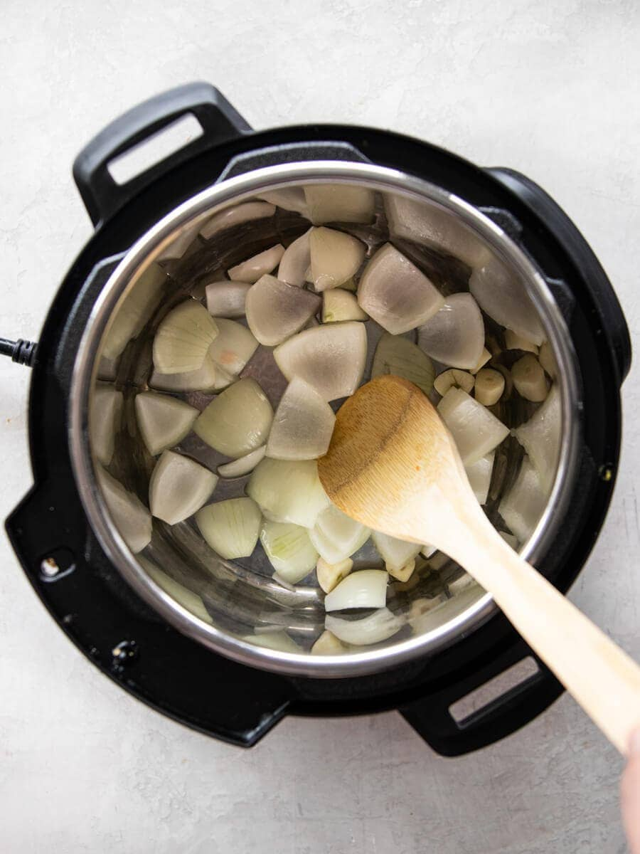 Onions and garlic being sautéed in the Instant Pot