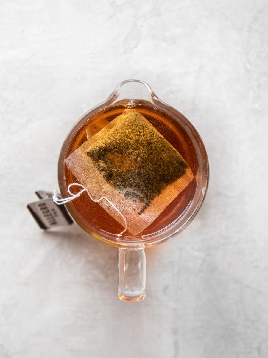 Bag of Earl Grey tea seeping in hot water
