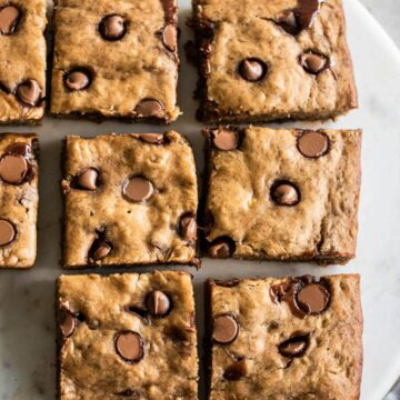 Chocolate chip banana bars sliced and placed on marble platter.