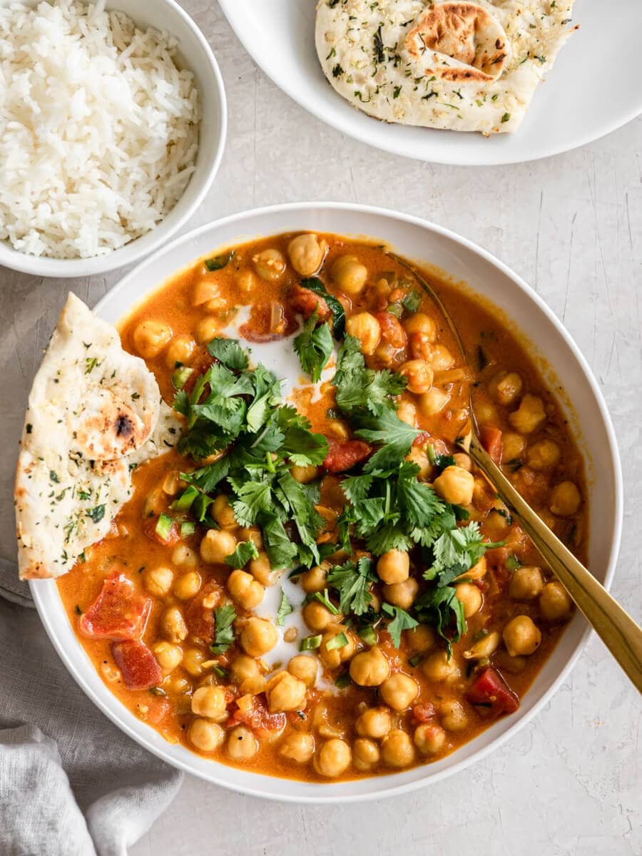 Coconut chickpea curry with rice and naan.