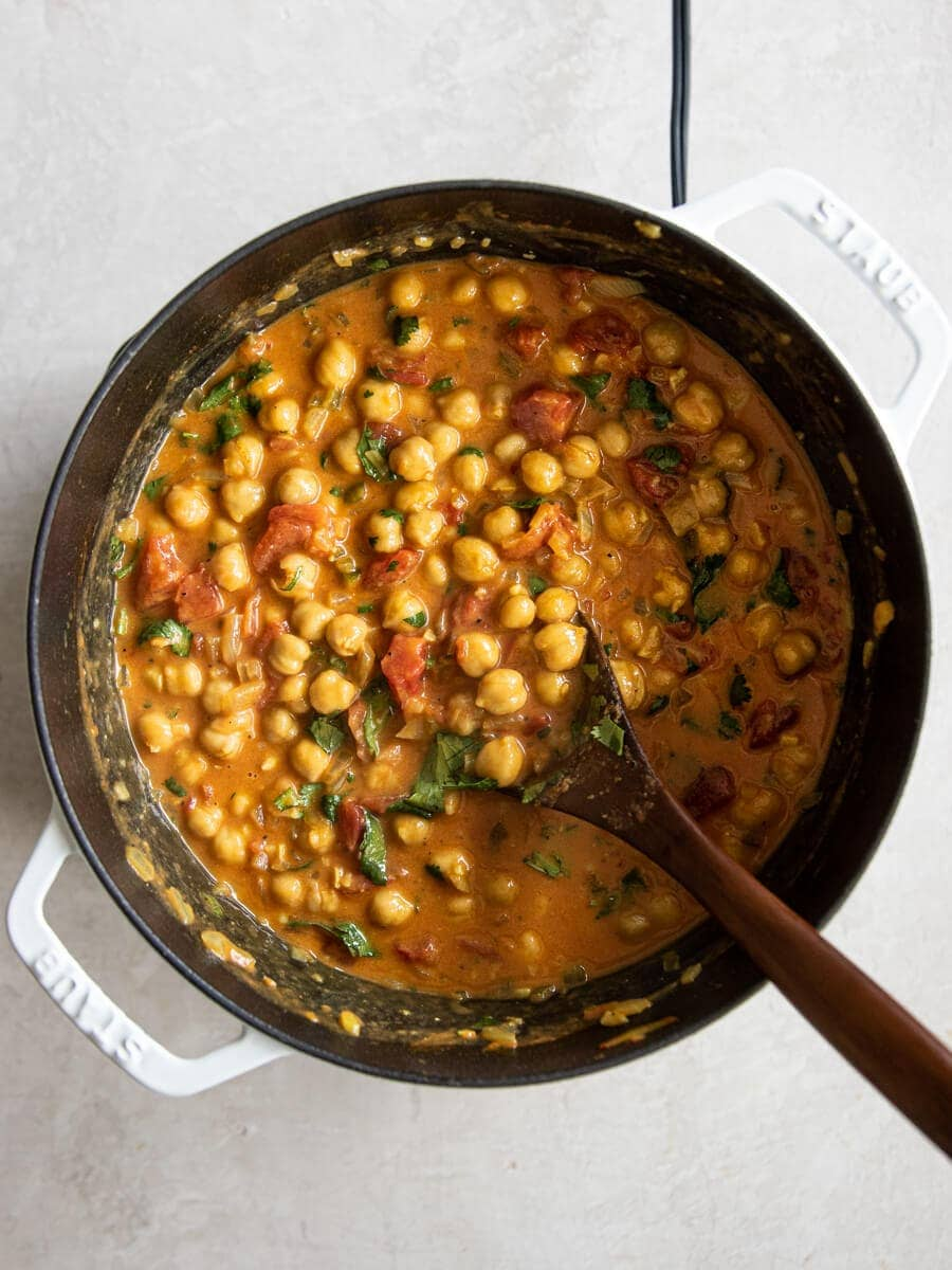 Pot of cooked coconut chickpea curry.