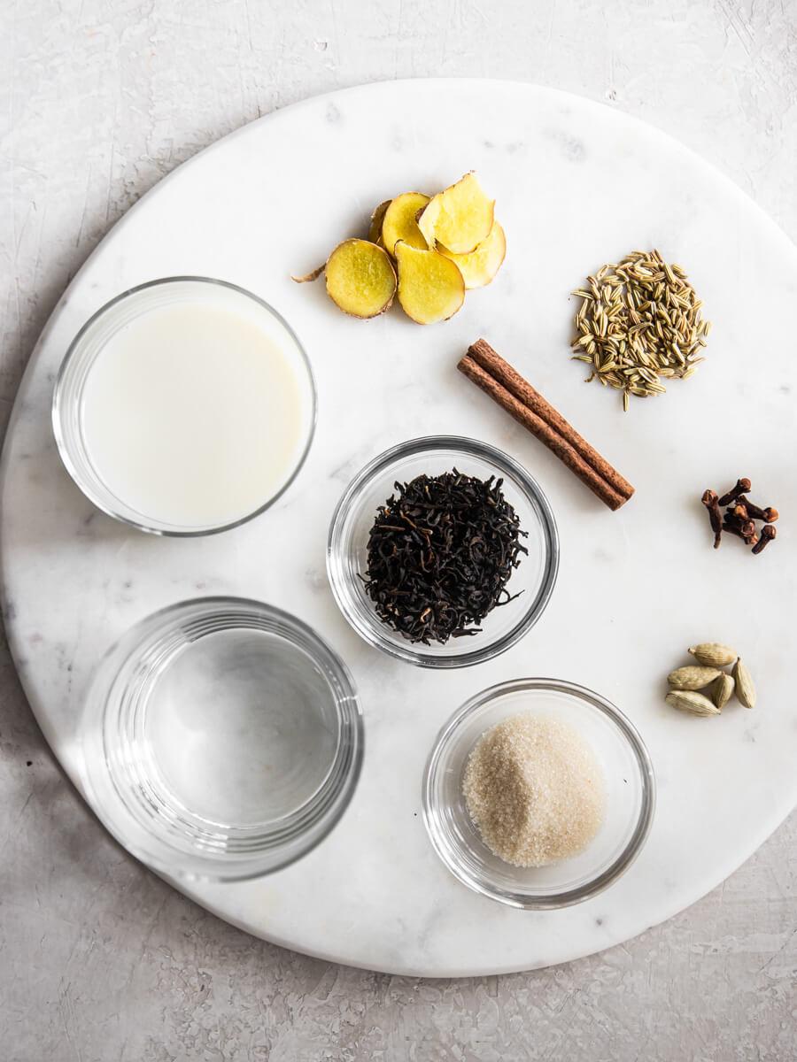 Ingredients for chai on marble platter.