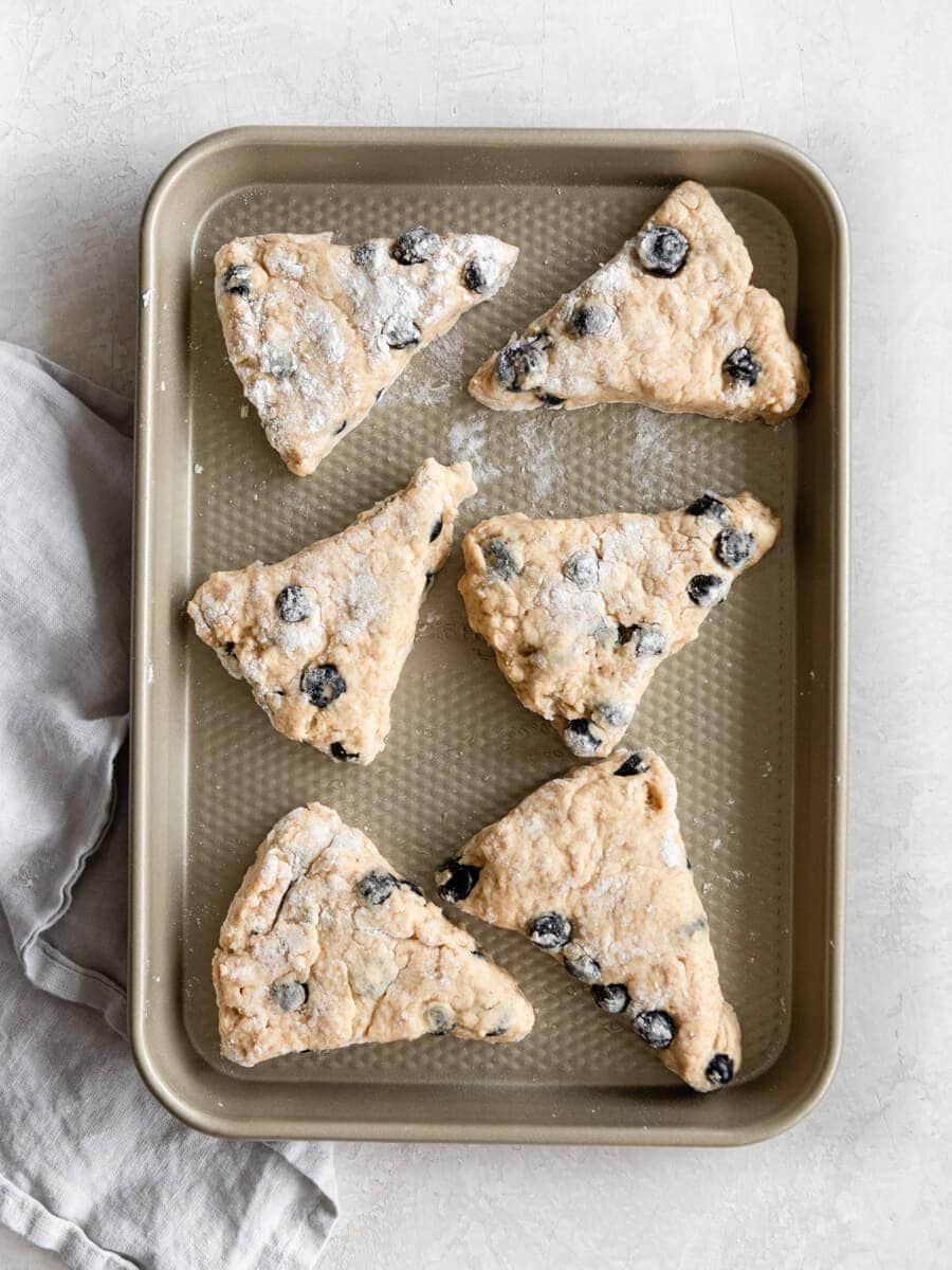 Blueberry scone pieces on baking sheet.