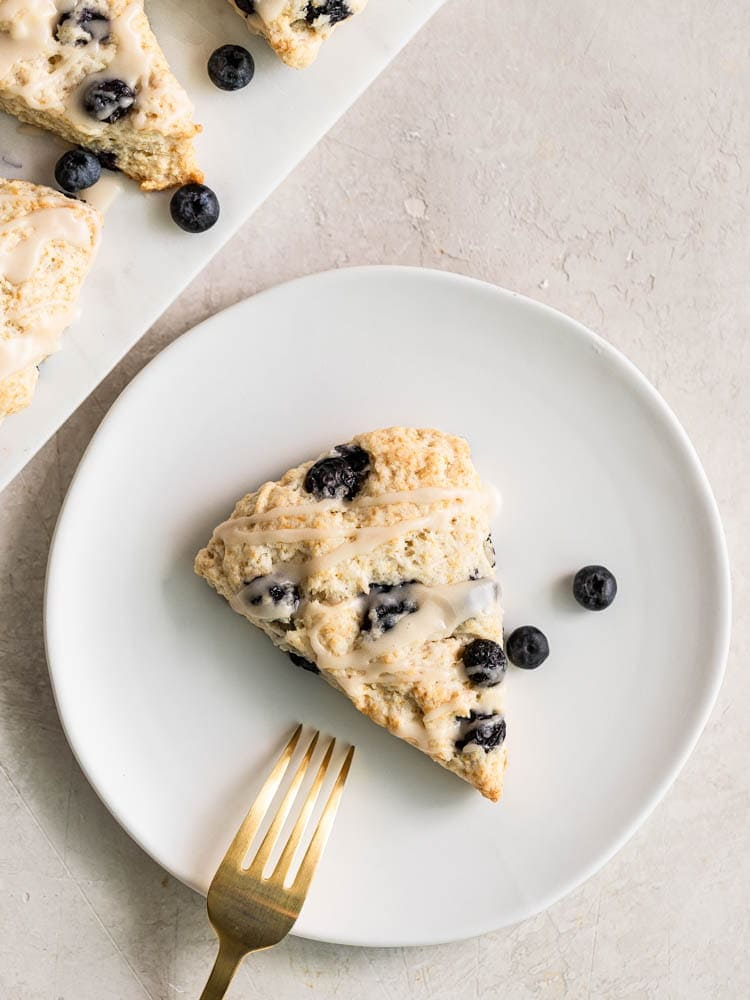 Scone on a plate with a fork