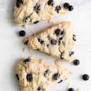Three vegan blueberry scones on a platter
