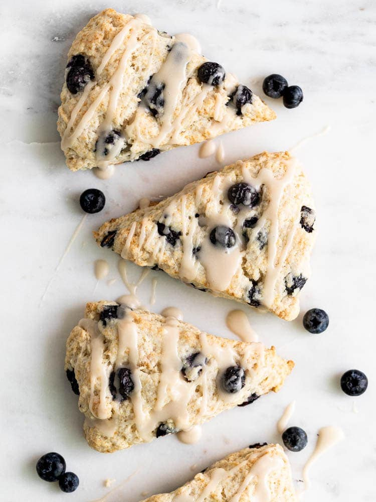 Three vegan blueberry scones on a platter