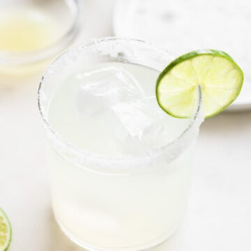 Classic margarita with a bowl of lime juice.