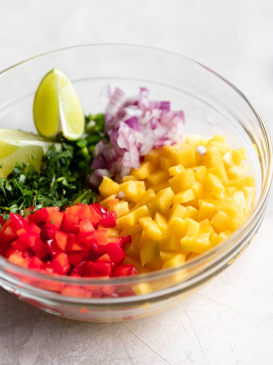 Ingredients for salsa in bowl.